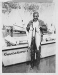 Tom McCall Catches Salmon by Unknown