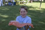 Young Boy Holding Salmon by John Rizzo