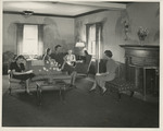 Women Socializing in Failing Hall Lounge by Unknown