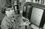 Martha McClure Ezell Operates MicroBook Machine