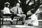 Professor Frank Nelson and Students Outdoors by Unknown
