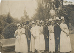 Students and Interns on the Lawn by Unknown