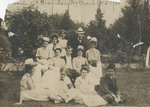 Students Seated on the Lawn 03 by Unknown