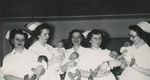 Nurses Holding Newborn Babies by Unknown