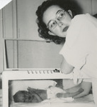 Nursing Student with a Newborn Baby