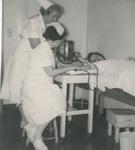 Nurses Taking Blood by Unknown