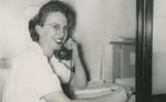 Nurse Talking on Phone by Unknown