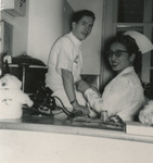 Nurse and Intern at Front Desk by Unknown