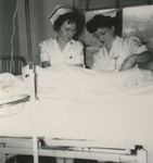 Nurses Checking Patient by Unknown