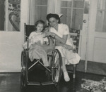 Nursing Student with Child in Wheelchair by Unknown