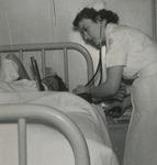 Nursing Student Using Stethoscope by Unknown