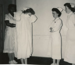Nursing Student Wearing Isolation Unit Attire by Unknown
