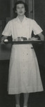 New Nurse Holding Tray of Food by Unknown