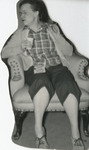 Nursing Student Relaxing in Chair by Unknown