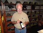 Earl Jones Holding Wine Bottle