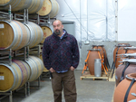 Andrew Beckham with French Oak Barrels by Linfield College Archives