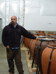 Andrew Beckham with Amphorae Vessels by Linfield College Archives
