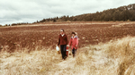 Ted Casteel and Pat Dudley Walk the Vineyard by Unknown