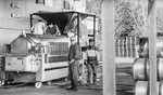 Terry and Ted Casteel with Grape Sorting Machine by Unknown