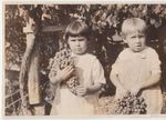 Two Children Holding Grapes by Unknown