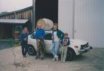 Girardet Family and Car with Wine Barrel