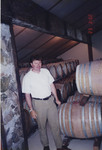 Michel Ponzi among Wine Barrels by Unknown