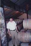 Michael Ponzi Among Wine Barrels
