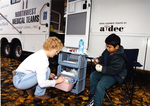 Woman Assists Child at ¡Salud! Clinic
